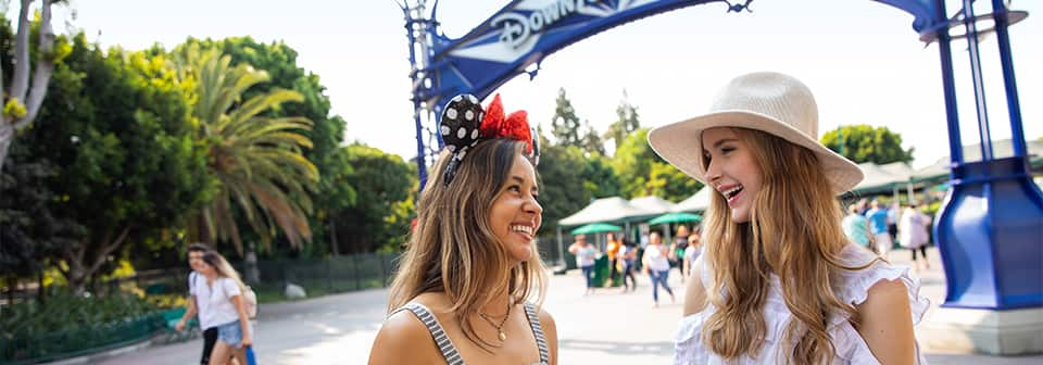 2 Guests laugh together at Downtown Disney District