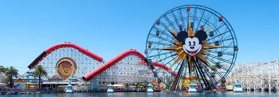 A view of Pixar Pal A Round Swinging and the Incredicoaster at Pixar Pier