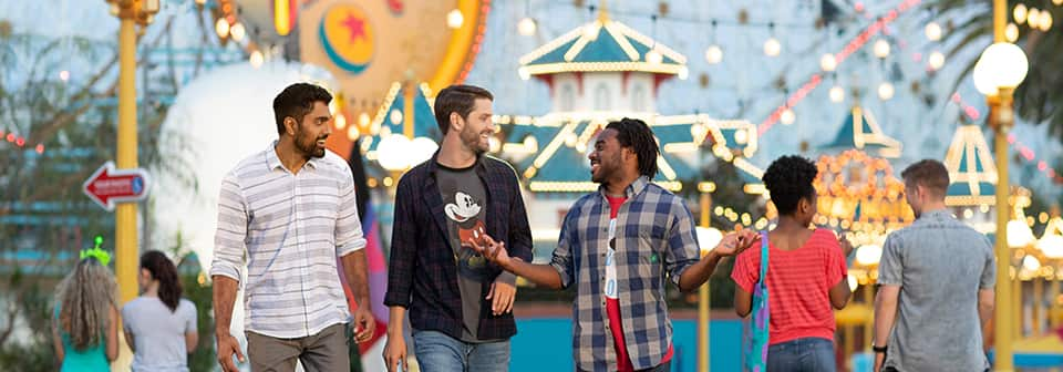 Attendees smiling while walking in Disney California Adventure park