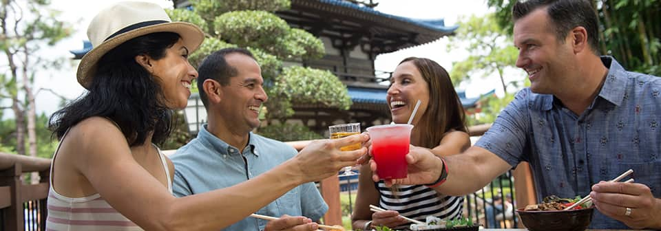 Attendees enjoying food and drinks by the Japan Pavilion in Epcot