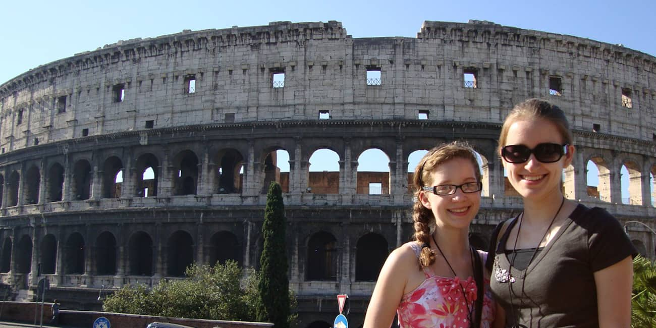 Mary Westerman and daughter pose for a picture in front of the Colosseum