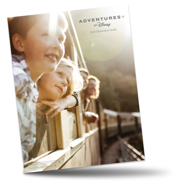 The Adventures by Disney 2020 Destination Guide logo on an image of a boy, a girl and their parents looking out at the passing scenery from their windows on a train